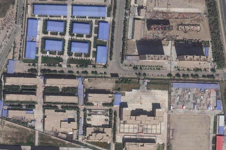 A+satellite+image+taken+in+September+shows+an+internment+camp+in+Xinjiang.+The+buildings+in+the+upper+left+corner+appear+to+be+of+a+design+commonly+used+by+factories.